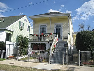 "East Riverside, New Orleans - ""Raised shotgun"" style house, 19th century residential architecture in the neighborhood"