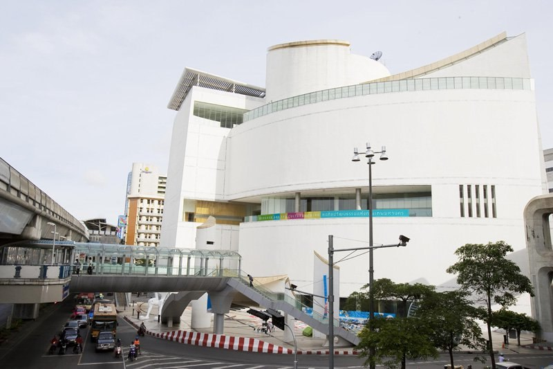 A modern-looking building with a smooth curved exterior on the corner of a road junction