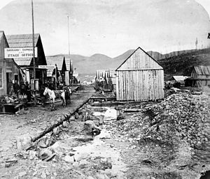 Cariboo Gold Rush - Barkerville (1865), shown rebuilt after the Great Fire, with its new, straightened and wider, Main Street. The creek in the foreground is Williams Creek, which is paralleled by Main Street throughout.
