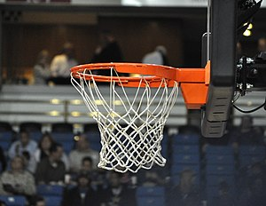 Backboard (basketball) - A basketball net and hoop attached to a backboard