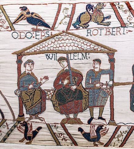 Detail of the Bayeux Tapestry showing William the Conqueror (centre), his half-brothers Robert, Count of Mortain (right) and Odo, Bishop of Bayeux in the Duchy of Normandy (left). The Bayeux tapestry is one of the supreme achievements of the Norman Romanesque. Bayeux Tapestry scene44 William Odo Robert.jpg