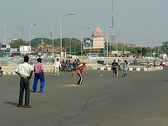 Forms of cricket - Street cricket on the Beach road in Chennai in India.