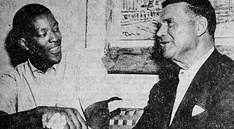 Frank Lane - Lane (right) shaking the hand of Bill McGill after he signed with the Chicago Packers in May 1962