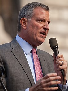 Mayor Bill de Blasio is seen talking into a microphone.