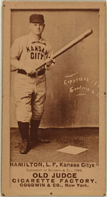 "Baseball card picturing a man in a white baseball uniform which reads ""KANSAS CITY"" on the chest"". Below him the card reads ""HAMILTON, LF, Kansas Citys""."