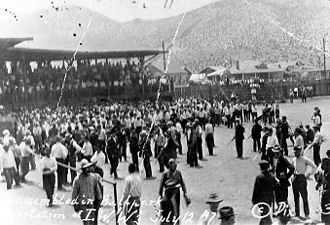 Bisbee Deportation - Striking miners and others rounded up by the armed posse on July 12, 1917, sit in the bleachers in Warren Ballpark. Armed members of the posse patrol the infield.