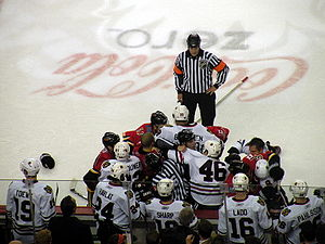 Fighting in ice hockey - Officials trying to break up a brawl between Calgary Flames and Chicago Blackhawks