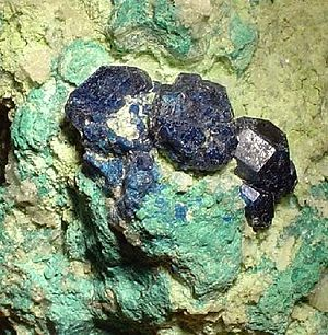 Santa Rosalía, Baja California Sur - Boleite (dark blue) and atacamite (blue-green) in clay, a high-grade ore specimen from Boleo.