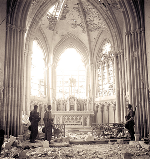 Carpiquet - Unidentified Canadian Infantry in a Bombed Out Church in Carpiquet, near Caen, July 12, 1944. Photo: Ken Bell