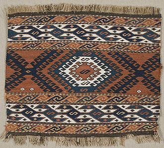Soumak - Soumak Mafrash (bedding bag) panel, from  Borchali, Georgia, late 19th century. The pattern includes motifs used on kilims, such as the eye, cross, and hook, to ward off the evil eye; the central diamond-shaped motif represents the dragon.