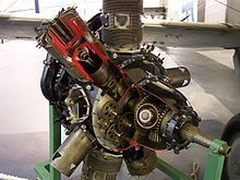 A Bristol Perseus air-cooled radial aircraft engine, with sleeve-valves. The engine has been sectioned for display. One of the upper cylinders has been sectioned, showing inside the cylinder and cutting into the junk head.