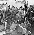"""British commandos who took part in Operation JUBILEE, the raid on Dieppe, returning to England, 19 August 1942 Débarquement de soldats revenant de l'opération """"Jubilee"""", le raid sur Dieppe (4679192558).jpg"""