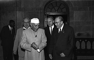 1945–60 in Western fashion - Indian Prime Minister Jawaharlal Nehru wearing mandarin collar suit and fez on a visit to East Germany, 1959.