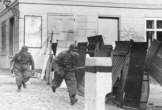 East Pomeranian Offensive - German infantrymen during street fighting in Wollin, March 1945