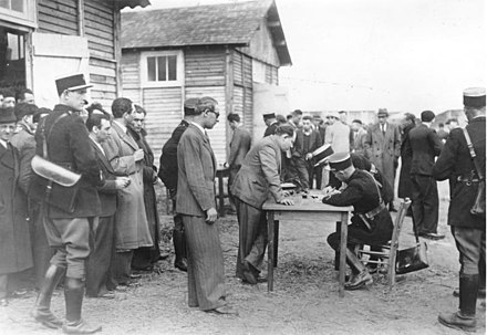 French Police registering new inmates at the Pithiviers camp Bundesarchiv Bild 183-S69238, Frankreich, Internierungslager Pithiviers.jpg