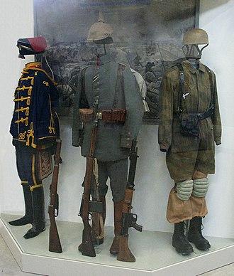 Wehrmacht uniforms - Paratrooper's knochensack worn over the standard Luftwaffe jumpsuit (right)