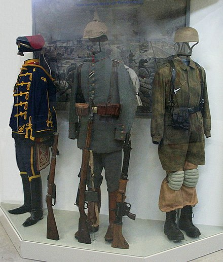 Paratrooper's knochensack worn over the standard Luftwaffe jumpsuit (right) - World War II German uniform
