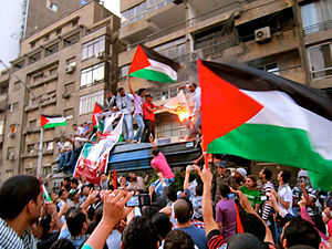 2011 attack on the Israeli Embassy in Egypt - On 15 May 2011, Egyptian protesters waved Palestinian flags in front of the Israeli embassy in Giza as they burned a makeshift Israeli flag.