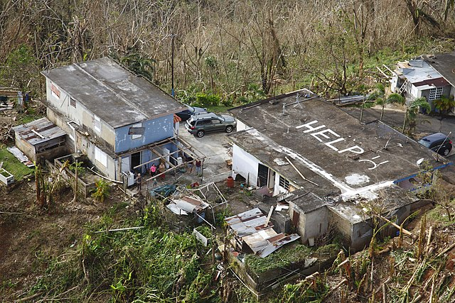House w/HELP painted on roof in Puerto Rican Mountains