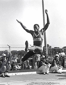 Lewis performing the long jump at the University of Houston 10b7fa974