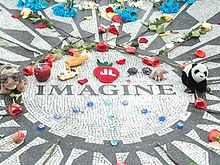 Strawberry Fields memorial strewn with flowers, toys and fruit