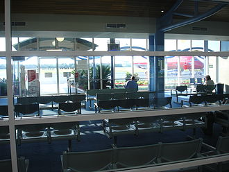 Coffs Harbour Airport - View of departures lounge, in the middle of the terminal, with a Virgin Blue E190 on the tarmac in the background
