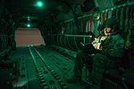 Ch-47 Chinook crew member reads book prior to mission 160222-A-XH155-163.jpg