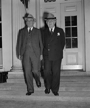 Reorganization Act of 1939 - Charles Merriam (left) and Louis Brownlow, members of the Brownlow Committee, leave the White House on September 23, 1938, after discussing government reorganization with President Roosevelt.