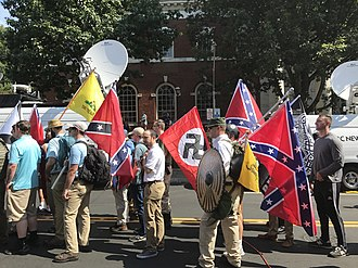 Unite the Right rally - Protesters at the rally carrying Confederate flags, Gadsden flags, and a Nazi flag