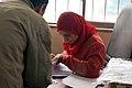 Checking names in early voting - Flickr - Al Jazeera English.jpg