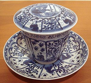 "Chinese export porcelain - Chinese blue and white export porcelain, with European scene and French inscription ""The Empire of virtue is established to the end of the Universe"", Kangxi period, 1690–1700."
