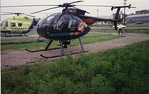 "WCMH-TV - The old WCMH TV ""Chopper 4"" landed at Wellston Heliport Base while covering a breaking news story as, Grant Lifeflight II's BK 117 N4493X sits on the pad. It was later replaced by the helicopter pictured below in the early 2000 (picture taken by Earl Wilbur and was used with the photographer's permission)."