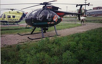 """WCMH-TV - The old WCMH TV """"Chopper 4"""" landed at Wellston Heliport Base while covering a breaking news story as, Grant Lifeflight II's BK 117 N4493X sits on the pad. It was later replaced by the helicopter pictured below in the early 2000 (picture taken by Earl Wilbur and was used with the photographer's permission)."""