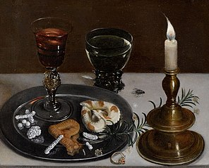 Still life with dainties, rosemary, wine, jewels and a burning candle