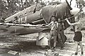 Cleaning guns of 83 Squadron RAAF Boomerang Nov 1943 AWM 060743.jpg