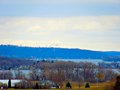 Columbia Energy Center Stacks Peaking over the Lake WI Bluffs - panoramio.jpg