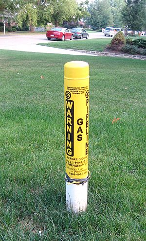 Columbia Gas Transmission - A warning marker indicating an underground gas line