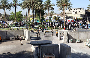 Kadhimiya - Pilgrims march outside Camp Justice.