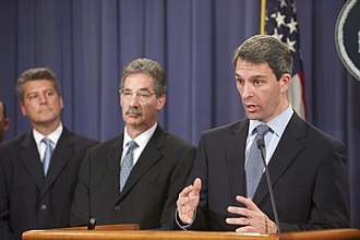 Ken Cuccinelli - Cuccinelli (right) speaking at US Department of Justice announcement of resolution with Abbott Laboratories for its off-label promotion of the drug Depakote