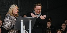Cynthia and Julian Lennon at the unveiling ceremony of the John Lennon Peace Monument in Liverpool - celebrating John Lennon's 70th Birthday - October 9th 2010.jpg