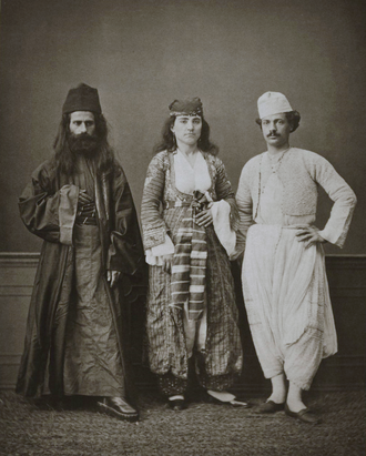 Greek Cypriots - Traditional costumes of (from right to left) a Christian resident of Magossa (Famagusta), a Christian woman of Magossa, and a Greek monk of the Monastery of Tchiko, near Lefke (Lefka).