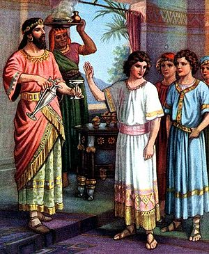 Daniel (biblical figure) - Daniel refusing to eat at the King's table, early 1900s Bible illustration