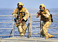 Defense.gov News Photo 100407-N-4774B-282 - Members of a visit board search and seizure team from the littoral combat ship USS Freedom LCS 1 conduct tactical exercises aboard the.jpg