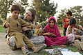 Defense.gov News Photo 100821-F-5281B-142 - U.S. Air Force Capt. Mary Danner-Jones a public affairs officer with the Nangarhar Provincial Reconstruction Team teaches an Afghan boy and his.jpg