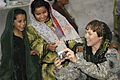 Defense.gov News Photo 101009-F-9227G-171 - U.S. Army Capt. Marie Orlando shows Afghan girls photos during their weekly Girl Scout meeting at Forward Operating Base Finley-Shields.jpg