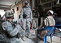 Defense.gov News Photo 101205-A-7998M-001 - U.S. Army Staff Sgt. Brain Sewick left a platoon sergeant with Tactical Psychological Operations Team 1316 asks a series of questions to Afghans.jpg