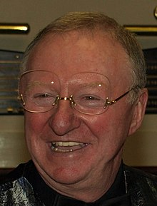 A picture of Dennis Taylor smiling