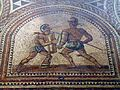 Detail of the Gladiator mosaic floor, a Hoplomachus fighting a Thraex, Römerhalle, Bad Kreuznach, Germany (8196100885).jpg