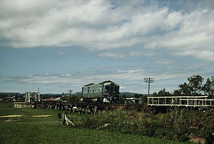 Southern railway line - 1901 crosses the Condamine River floodplain trestles on approach to Warwick station in 1987