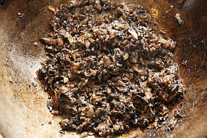 Paste (food) - Duxelles being cooked, which is eventually reduced into a paste